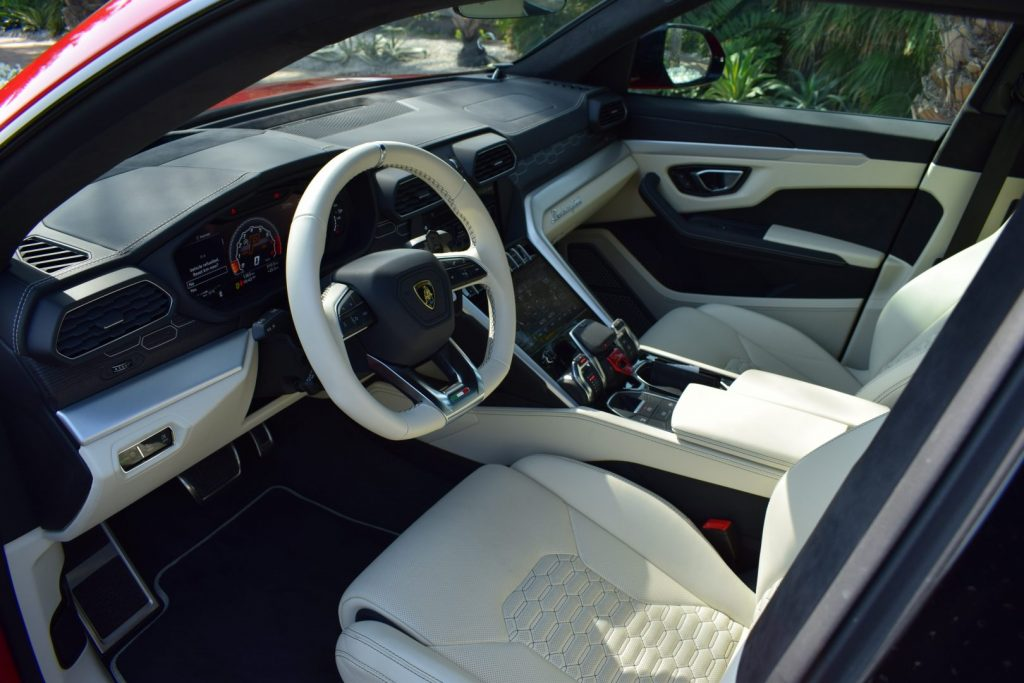lamborghini urus red color in dubai interior