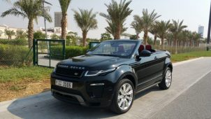range rover evoque black with trees dubai